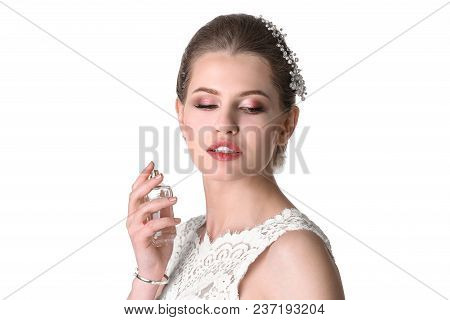 Beautiful Young Bride With Bottle Of Perfume On White Background