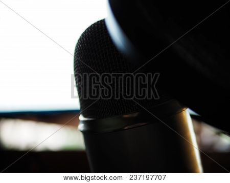 The Microphone With Pop Filter On It