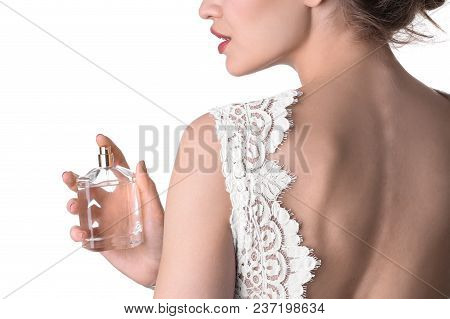 Beautiful Young Bride With Bottle Of Perfume On White Background, Closeup