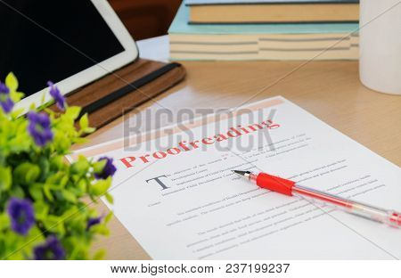 Proofreading Paper On Table In Office For Business