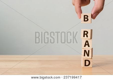 Hand Of Male Putting Wood Cube Block With Word