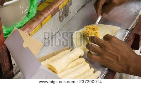 Raw Lumpia Seller Using Spoon Server Buyer And Sell Photo Taken In Indonesia Semarang Central Java