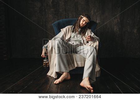 Drunken man in the image of Jesus Christ