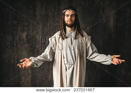 Jesus Christ praying with open arms