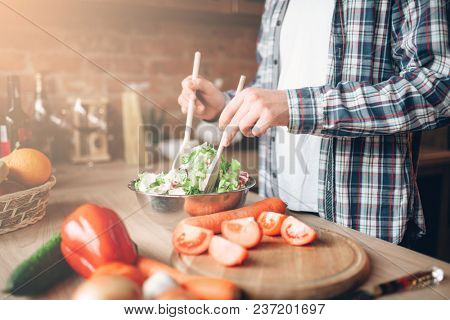 Man and woman hands, vegetable salad cooking