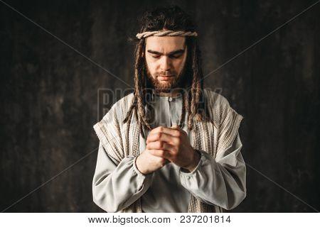 Man in the image of Jesus Christ praying
