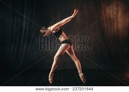 Classical ballet dancer in black practice training