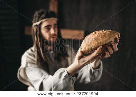Jesus Christ with bread in hands, sacred food