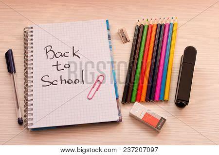 Various School Accessories On The Desk . Back To School . School Concept .