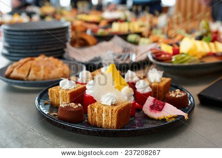 Desserts, fruits and other food on banquet table, catering event
