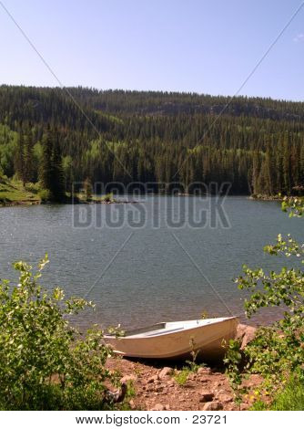 Rowboat By Mountain Lake