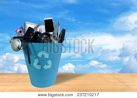 Electronic Waste Broken Or Damage In Recycle Bin On Sky And Clouds Background, Reuse And Recycle Con