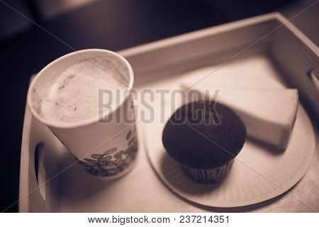 Chocolate Cake On A Wooden Tray. Photo With Filter. Background
