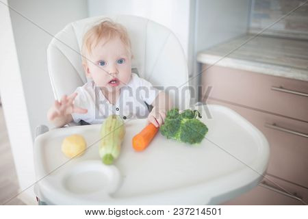 The Baby Is Eating Vegetables.