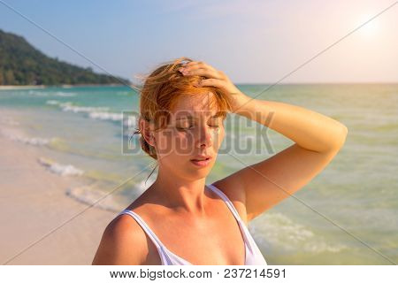 Woman Having Sun Stroke On Sunny Beach. Woman On Hot Beach With Sunstroke. Health Problem On Holiday