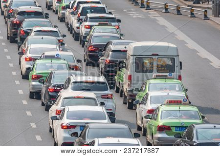 Chengdu, Sichuan Province, China - April 18, 2018 : Two Lanes Of Car Traffic In A Large Avenue