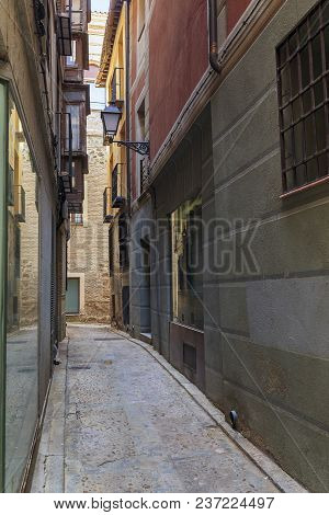 Toledo, Spain - May 25, 2017: It Is One Of The Oldest Narrow Laynes Of A Medieval City With New Glas