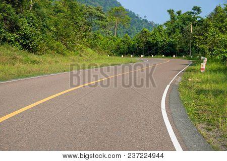 Empty Highway In Green Summer Landscape. Straight Road In Wild Forest. Summer Outdoor Travel Landsca