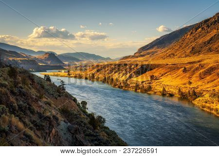 Thompson River At Sunset Along The Trans Canada Highway In British Columbia, Canada.