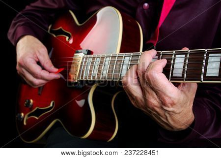 Guitarist Hands And Guitar Close Up. Guitar Chords