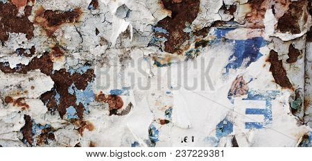 Old, Torn Bulletin Board. Street Empty Public Billboard, Dirty Wall With Rust. Bright Colorful Backg