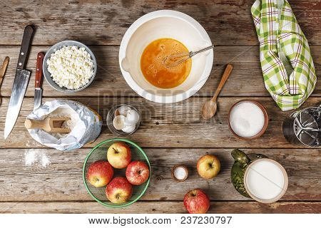 Ingredients And Utensils For The Preparation Of Bakery Products - Flour, Dough, Eggs, Rolling Pin, W