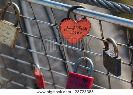 Many Love Locks On Fence Concept With Selective Focus On A Blank Lock At Foreground