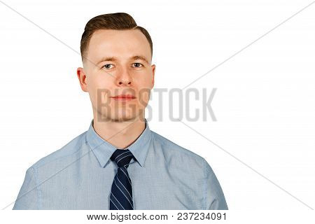 Portrait Of Young Businessman Dressed In Blue Shirt And Tie, Isolated On White Background