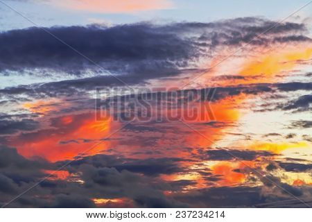Layered Forms Of Beautiful Clouds With Red Sunset.
