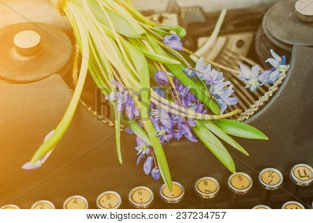 Antique Black Vintage Typewriter With Blue Romantic Spring Flowers
