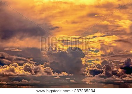 Beautiful Clouds With An Orange Evening Sunset.