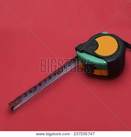 Construction Tape Measure, Red Background For Precise Craftsmanship At Work