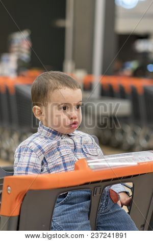 Toddler In The Cart In The Supermarket.