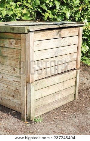 A Wood Compost Bin With Organic Material