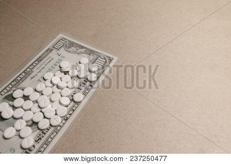 A Pile Of Tablets On One Hundred Dollar Bill On The Gray Background With Copy Space
