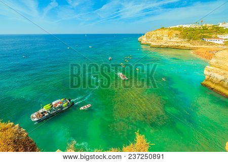Benagil, Portugal - August 23, 2017: Aerial View From Promontory In Algarge Coast Of Boats And Kayak