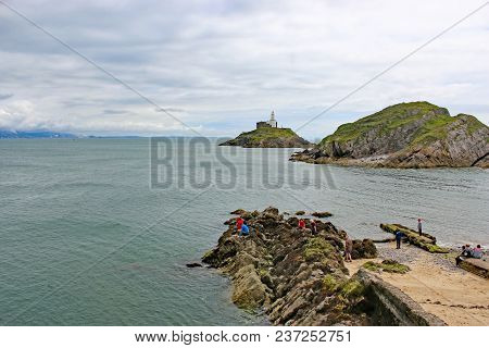 Mumbles Lighthouse And The Coast Of Swansea Bay, Wales