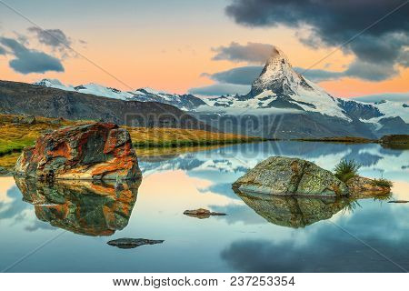 Breathtaking Sunrise Panorama With Famous Matterhorn Peak And Beautiful Alpine Lake, Stellisee, Vala