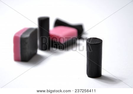 Black Licorice Sweets On A White Background. Benefit Or Harm