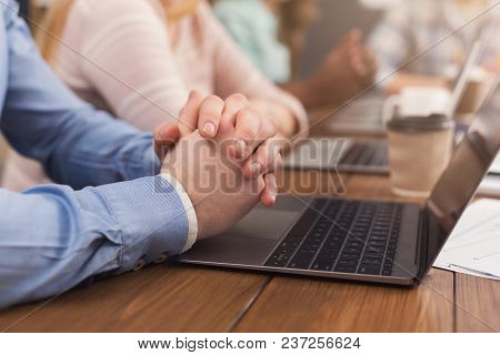 Unrecognizable Team Of Young Programmers Working In Software Developing Company, Sitting St Laptops,