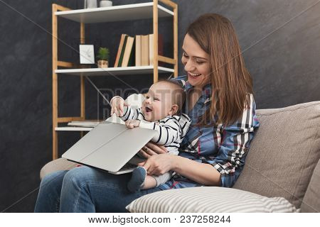 Happy Business Mom Working On Laptop In Office While Spending Time With Her Cute Baby. Business, Mot