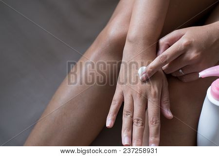 Woman Applying Moisturizing Cream On Her Hands,concept Healthy And Skin