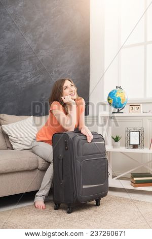 Young Pensive Woman Dreaming About Traveling Around World, Sitting With Packed Suitcase, Ready For A
