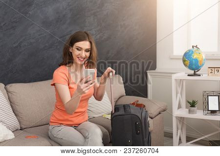 Young Cheerful Woman Got Message About Travelling, Sitting With Packed Suitcase, Ready For Annual Va