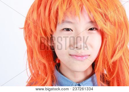 Happy Funny Asian Gay Boy With His Orange Hair Wig Over White Background (lady Boy)