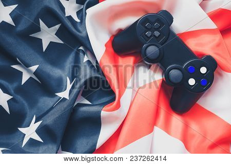 Joystick On Red And White Stripes And White Stars On Blue. Patriotic Mood. American Flag. Celebratio