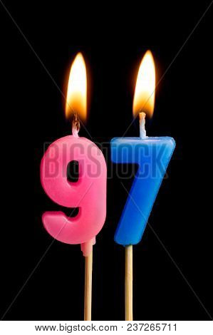 Burning Candles In The Form Of 97 Ninety Seven (numbers, Dates) For Cake Isolated On Black Backgroun