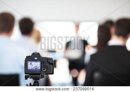 Making Video Of Business People At Meeting With Photo Camera