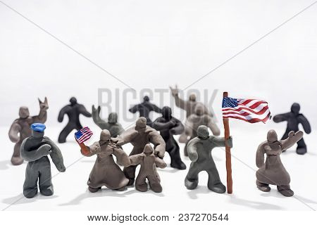 Patriot's Day Celebration. Abstract Photo. Figures Made From Play Clay.