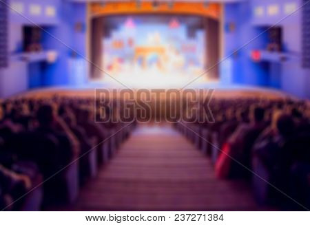 Defocused Image. Auditorium In The Theater During The Performance. The Scenery On The Stage. Adults